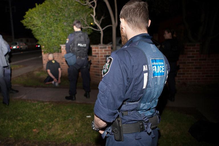Australian Federal Police detain a suspect in Sydney on September 18, 2014 during Australia's largest ever counter-terrorism raids