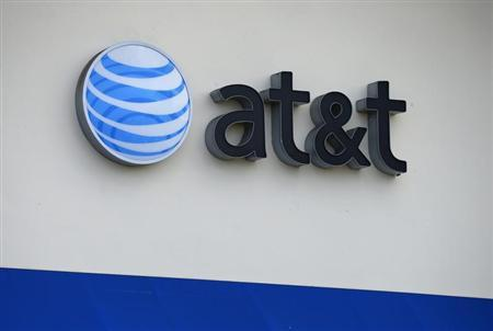 The AT&T logo is pictured by its store in Carlsbad, California