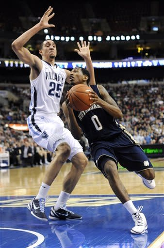 Notre Dame's Eric Atkins (0) drives past Villanova's Maurice Sutton (25) in the first half of an NCAA college basketball game on Saturday, Feb. 18, 2012, in Philadelphia. (AP Photo/Michael Perez)