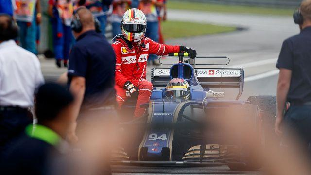 Vettel had to hitch a ride back to the pits. Image: Getty
