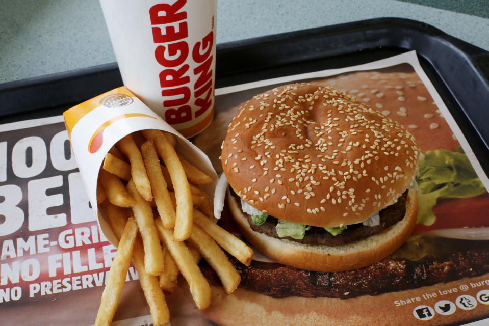 FILE- This Feb. 1, 2018, file photo shows a Burger King Whopper meal combo at a restaurant in Punxsutawney, Pa. Restaurant Brands International, the parent company of Burger King and Tim Hortons, reports financial results Monday, Feb. 11, 2019. (AP Photo/Gene J. Puskar, File)