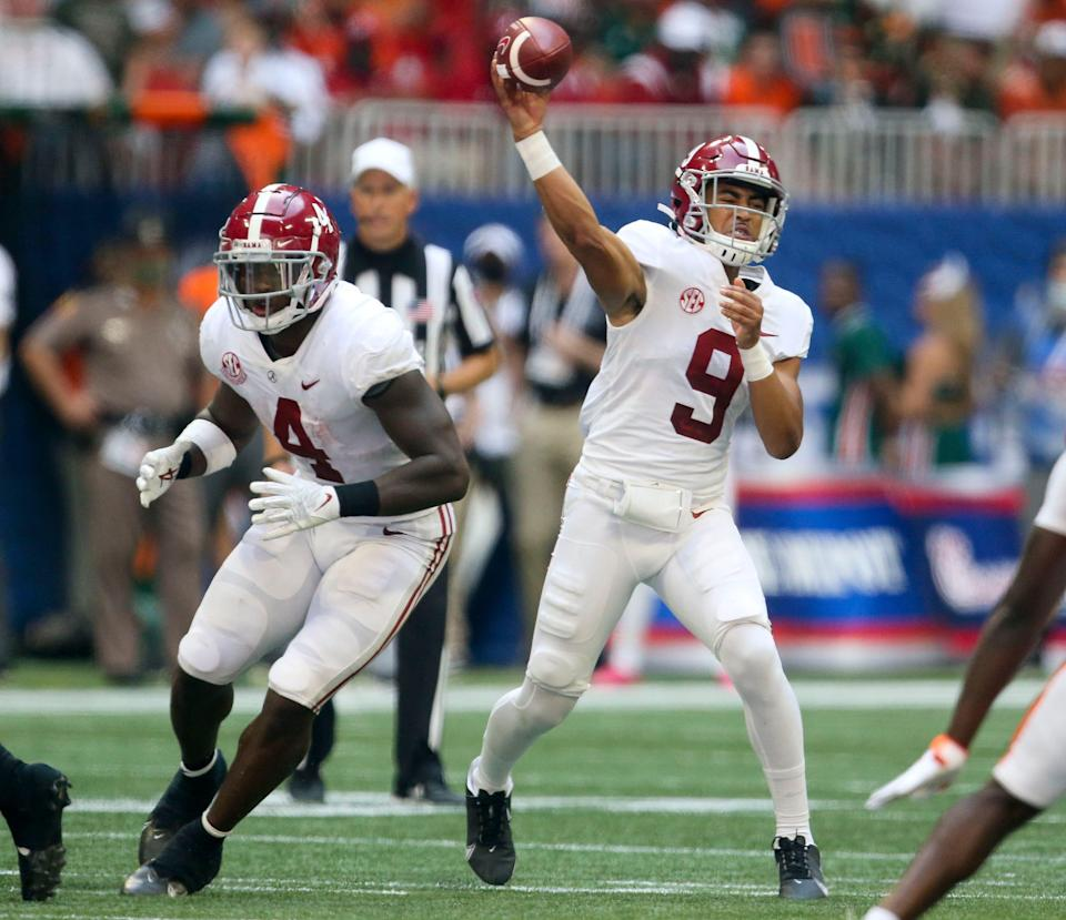Alabama quarterback Bryce Young (9) throws with Alabama running back Brian Robinson Jr. (4) looking to block against Miami at Mercedes-Benz Stadium. Mandatory Credit: Gary Cosby-USA TODAY Sports