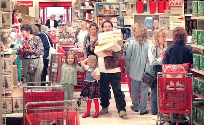 <p>Shoppers at a Simi Valley Target swarm the aisles to catch any post-Christmas deals.</p>