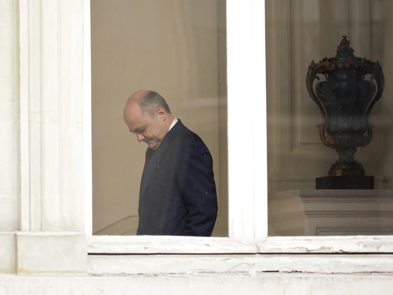Outgoing French Interior Minister Bruno Le Roux arrives to welcome his successor Matthias Fekl, prior to a handover ceremony, in Paris, Wednesday, March 22, 2017. Le Roux resigned Tuesday a few hours after prosecutors opened an investigation into a report that he hired his two daughters for a series of temporary parliamentary jobs, starting when they were 15 and 16 years old. (AP Photo/Thibault Camus)