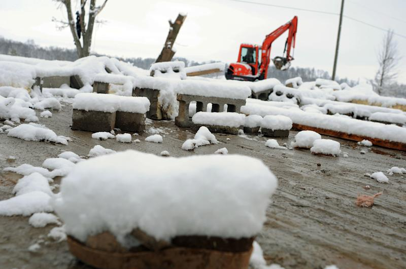 Snow-covered rubble from the destroyed mobile home of Joe Miller, 31, lies on the ground Monday, March 5, 2012, in New Pekin, Ind. A tornado slammed into Miller's home, killing a family that was taking shelter with him. Joseph Brough, 21, his wife, Moriah, 20, and children, Angel, 1, Jaydon, 2, and Kendall, 7-weeks, were killed. (AP Photo/Stephen Lance Dennee)