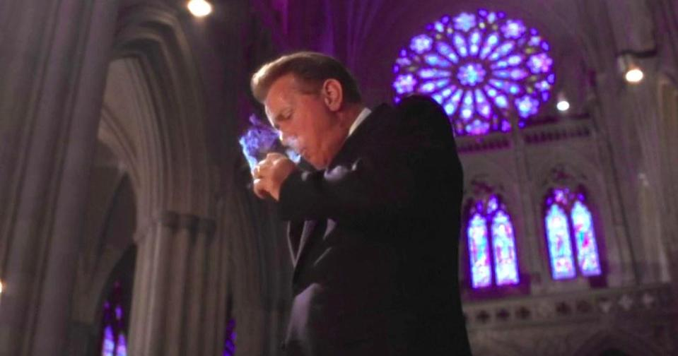 Bartlet smokes a cigarette in a cathedral