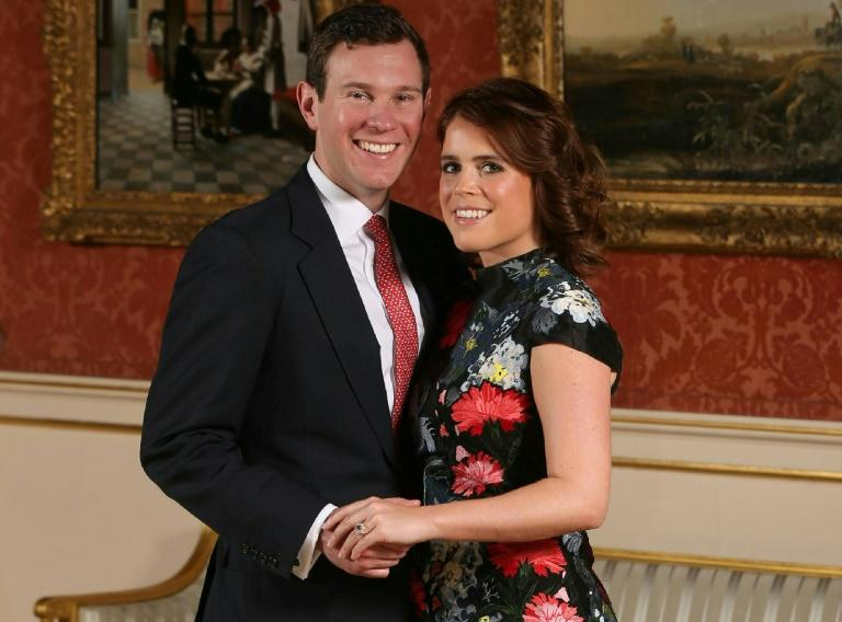 Britain's Princess Eugenie of York with her fiance Jack Brooksbank at Buckingham Palace after the announcement of their engagement