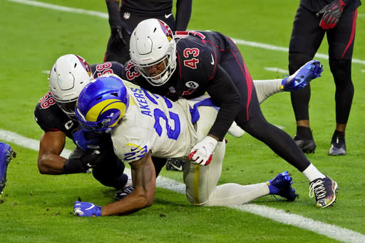 Los Angeles Rams running back Cam Akers (23) scores a touchdown as Arizona Cardinals outside linebacker Haason Reddick (43) and middle linebacker Jordan Hicks (58) defend during the first half of an NFL football game, Sunday, Dec. 6, 2020, in Glendale, Ariz. (AP Photo/Rick Scuteri)
