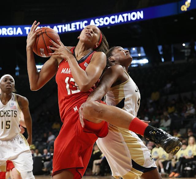 Maryland center Alicia DeVaughn (13) comes down with a rebound against Georgia Tech forward Roddreka Rogers (54) in the second half of an NCAA women's college basketball game, Sunday, Feb. 23, 2014, in Atlanta. (AP Photo/John Bazemore)