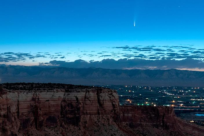 Comet Neowise soars in the horizon of the early morning sky in this view from the near the grand view lookout at the Colorado National Monument west of Grand Junction, Colo., Thursday, July 9, 2020.