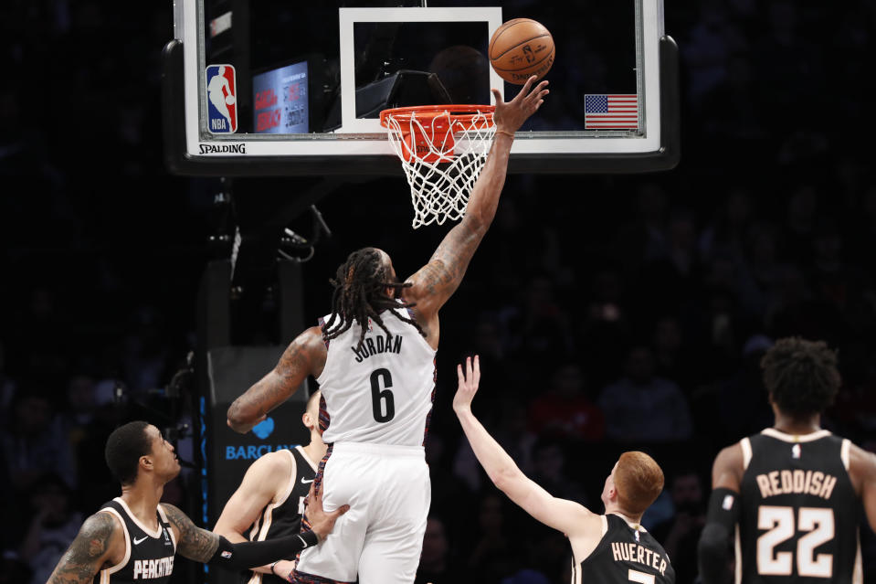 Brooklyn Nets center DeAndre Jordan (6) goes up for a shot with various Atlanta Hawks players defending during the first half of an NBA basketball game, Sunday, Jan. 12, 2020, in New York. (AP Photo/Kathy Willens)