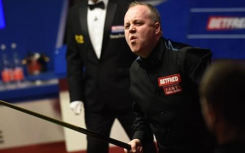 <span>John Higgins fights back against Mark Williams</span> <span>Credit: AFP </span>