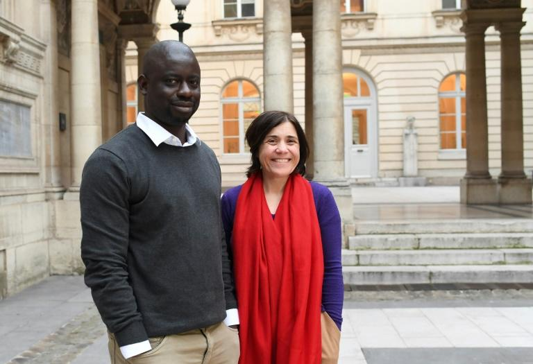 Emmanuel Macron has charged French art historian Benedicte Savoy and Senegalese writer Felwine Sarr with investigating how to give colonial-era African artefacts back