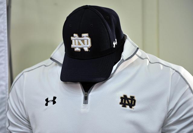 New Notre Dame coaching gear is displayed at a news conference Tuesday Jan. 21, 2014, in South Bend, Ind., announcing an agreement between Notre Dame and Under Armour that will outfit the university's athletic teams (AP Photo/Joe Raymond)