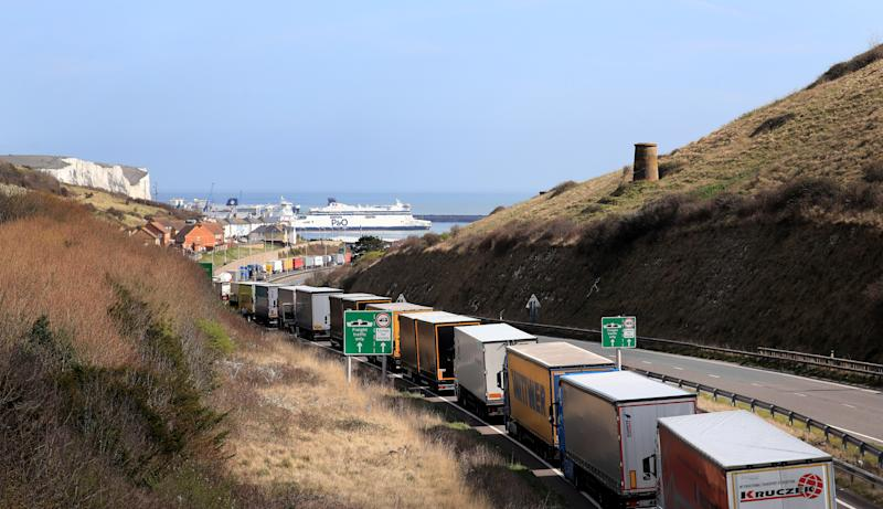 Lorries queue to enter the Port of Dover on the A20 in Kent. (Photo by Gareth Fuller/PA Images via Getty Images)