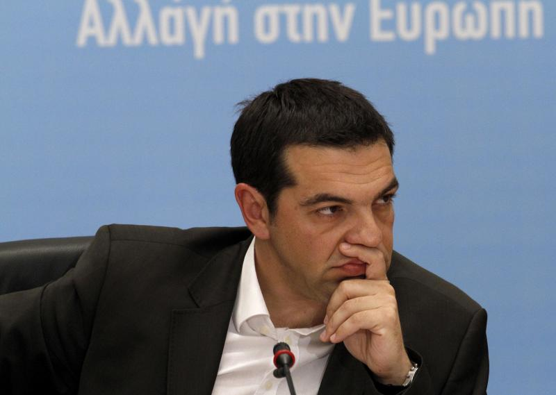 Head of Greece's Radical Left Coalition Alexis Tsipras listens in Athens, Tuesday, June 12, 2012. Tsipras, whose party came a surprise second in inconclusive May 6 elections, said he would stick to his pledge to tear up Greece's bailout deal, saying the austerity the country has been forced to impose in return for billions of euros in rescue loans was leading Greece towards collapse. (AP Photo/Petros Karadjias)
