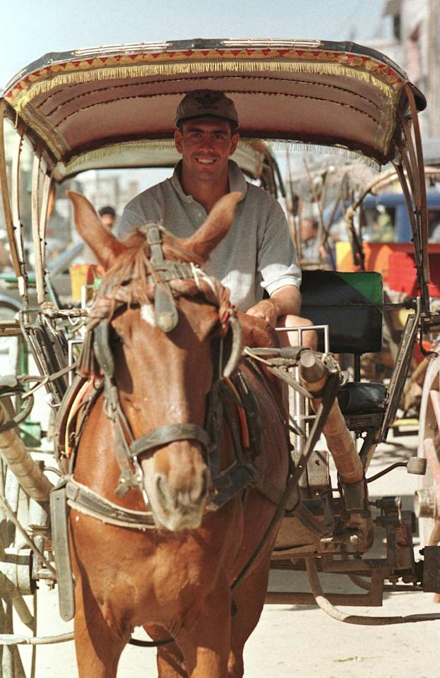 3 Mar 1996:  Captain Hansie Cronje of South Africa enjoys a ride in a horse-cart through the streets of downtown Rawalpindi, Pakistan. South Africa are to play Holland in the Cricket World Cup game in Rawalpindi on March 5th. Mandatory Credit: John Parkin/Allsport