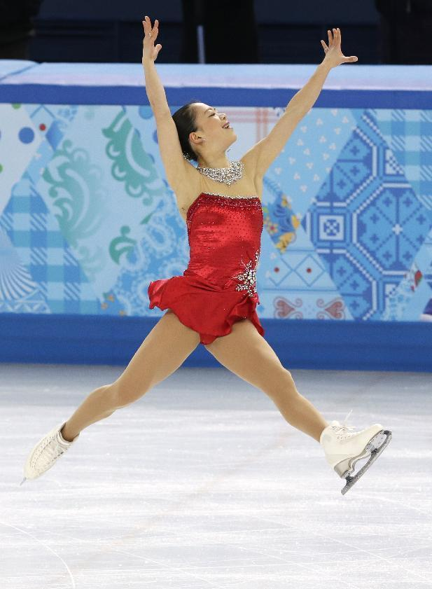 Akiko Suzuki of Japan competes in the women's short program figure skating competition at the Iceberg Skating Palace during the 2014 Winter Olympics, Wednesday, Feb. 19, 2014, in Sochi, Russia. (AP Photo/Darron Cummings)
