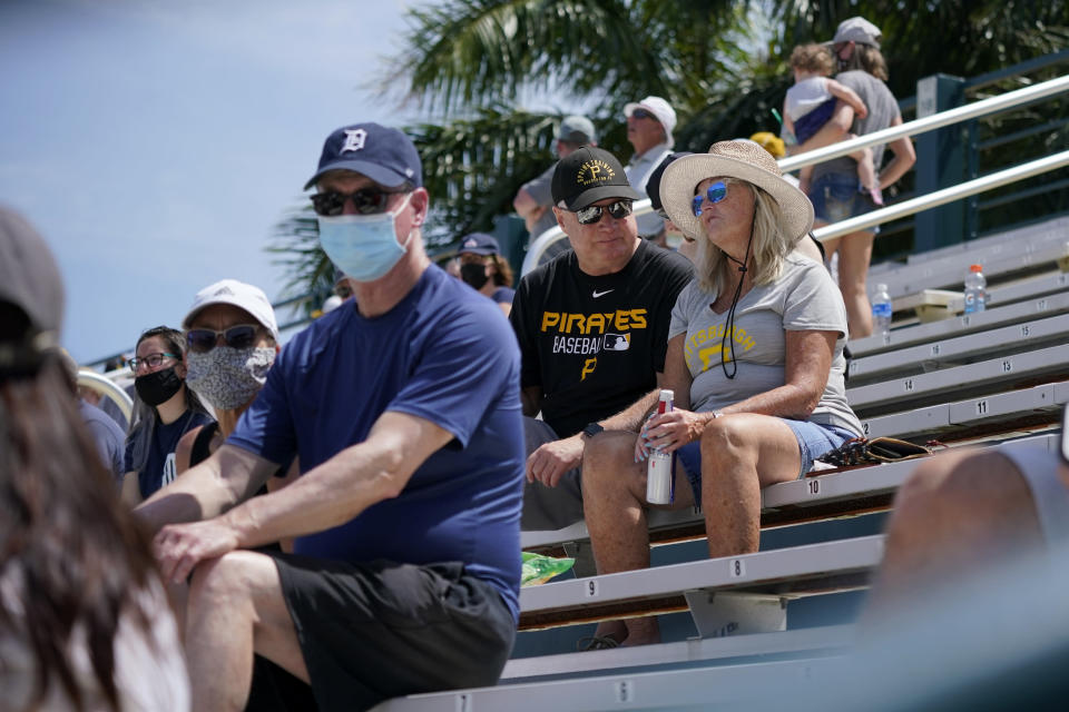 A limited number of socially distanced fans watch a spring training exhibition baseball game between the Pittsburgh Pirates and the Detroit Tigers at LECOM Park in Bradenton, Fla., Friday, March 26, 2021. Spring has arrived, and many older adults who have been vaccinated are emerging from hibernation imposed by the coronavirus pandemic. (AP Photo/Gene J. Puskar)