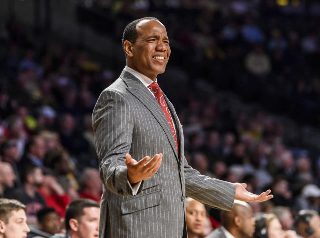 North Carolina State head coach Kevin Keatts tore his patellar tendon in a pickup game on Wednesday. (AP Photo/Danny Karnik)
