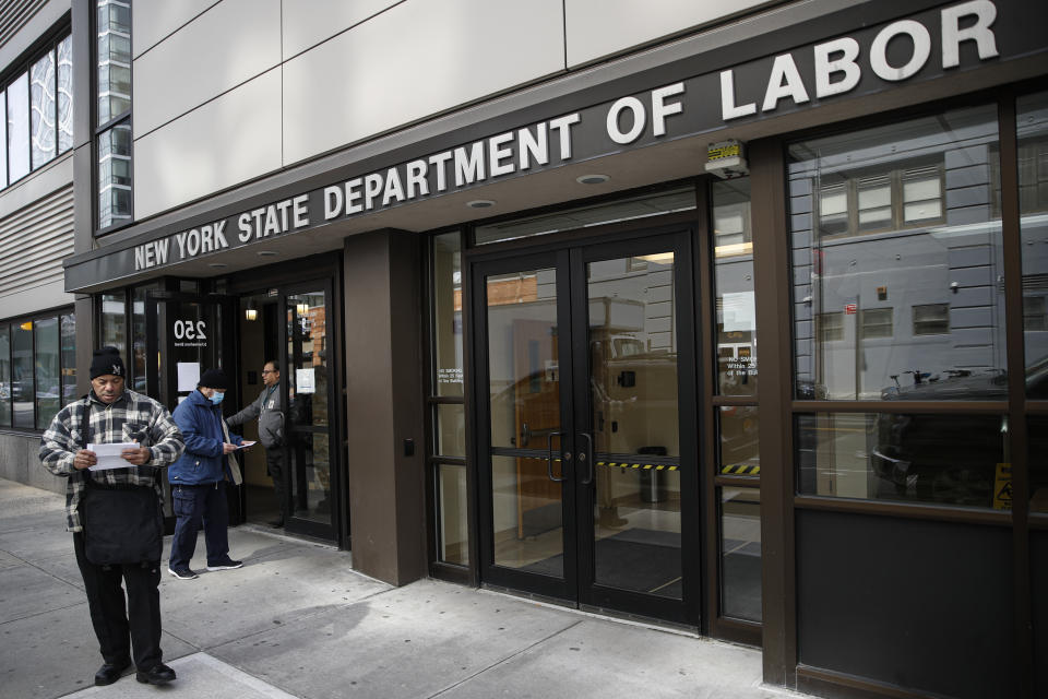 "Visitors to the Department of Labor are turned away at the door by personnel due to closures over coronavirus concerns, Wednesday, March 18, 2020, in New York. Mayor Bill de Blasio said New York City residents should be prepared for the possibility of a ""shelter in place"" order within days. De Blasio said Tuesday no decision had been made yet, but he wants city and state officials to make a decision within 48 hours given given the fast spread of the coronavirus. (AP Photo/John Minchillo)"