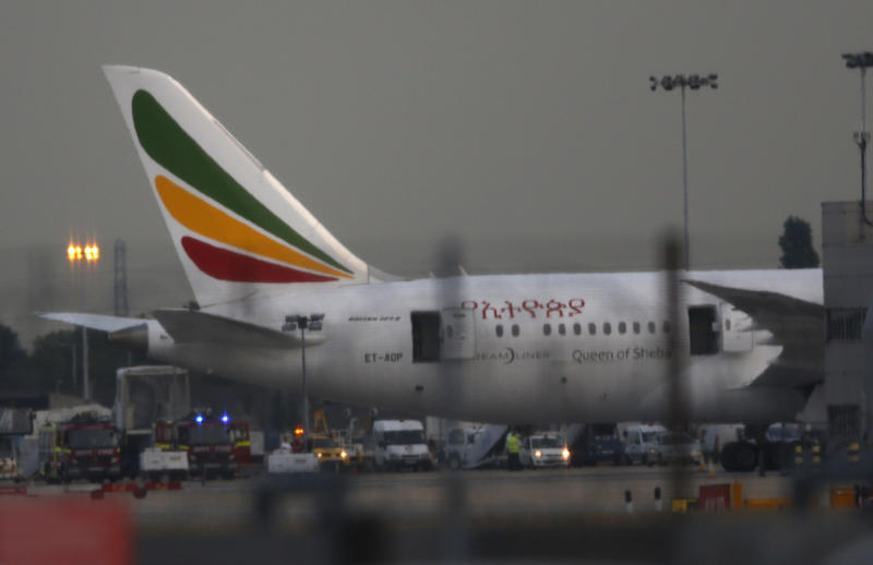 General view of the Air Ethiopian Boeing 787 Dreamliner 'Queen of Sheba' aeroplane, on the runway near Terminal 3, at Heathrow Airport, London, Friday July 12, 2013. Two Boeing 787 Dreamliner planes ran into trouble in England on Friday, with a fire on one temporarily shutting down Heathrow Airport and an unspecified technical issue forcing another to turn back to Manchester Airport. The incidents are unwelcome news for Chicago-based Boeing Co., whose Dreamliners were cleared to fly again in April after a four-month grounding due to concerns about overheating batteries. The fire at Heathrow involved an empty Ethiopian Airlines plane, which was parked at a remote stand of the airport after arriving at the airport. British police said the fire is being treated as unexplained, and that there were no passengers on board at the time of the fire. (AP Photo/Sang Tan)