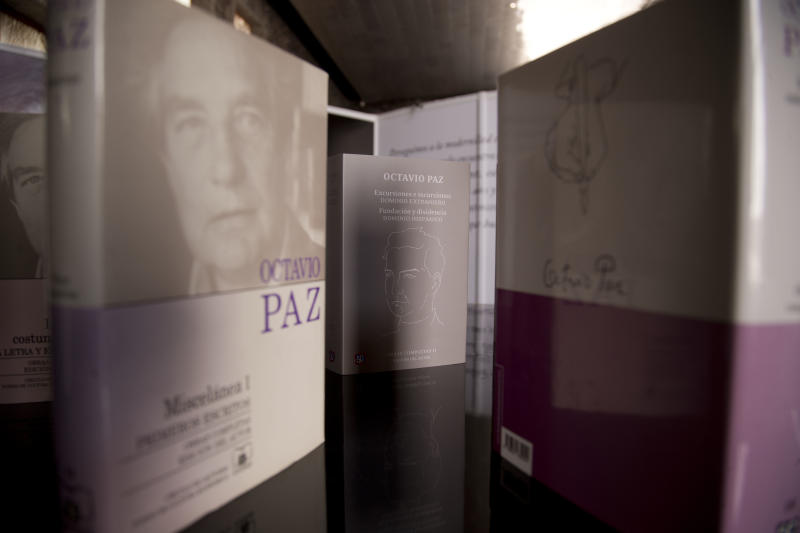 "Books by Mexican Nobel Prize poet and essayist Octavio Paz sit on display at an exhibit marking the 100th anniversary of his birth in Mexico City, Monday, March 31, 2014. Mexico's government and top poets are holding readings and exhibitions to remember Paz, whose most famous work was the 1950 essay ""The Labyrinth of Solitude."" Paz died 16 years ago. (AP Photo/Eduardo Verdugo)"
