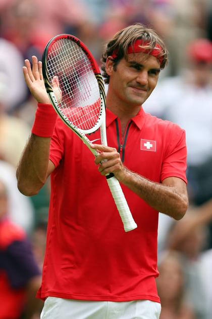 LONDON, ENGLAND - JULY 28:  Roger Federer of Switzerland celebrates after defeating Alejandro Falla of Colombia during their Men's Singles Tennis match on Day 1 of the London 2012 Olympic Games at the All England Lawn Tennis and Croquet Club in Wimbledon on July 28, 2012 in London, England.  (Photo by Clive Brunskill/Getty Images)