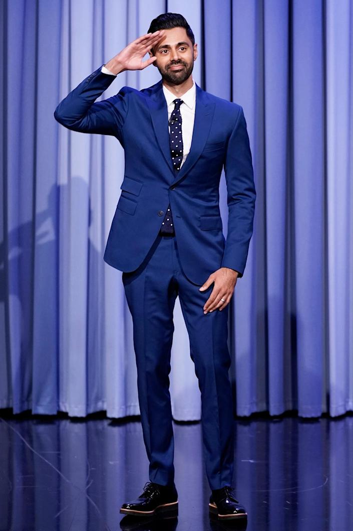 <p>Hasan Minhaj greets the cameras on Sept. 20 while hitting the set of <em>The Tonight Show</em> in New York City.</p>