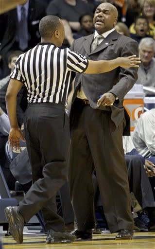 Georgetown head coach John Thompson III reacts to a foul called against his team during the second half of an NCAA college basketball game against West Virginia in Morgantown, W.Va., on Saturday, Jan. 7, 2012. West Virginia won 74-62. (AP Photo/David Smith)