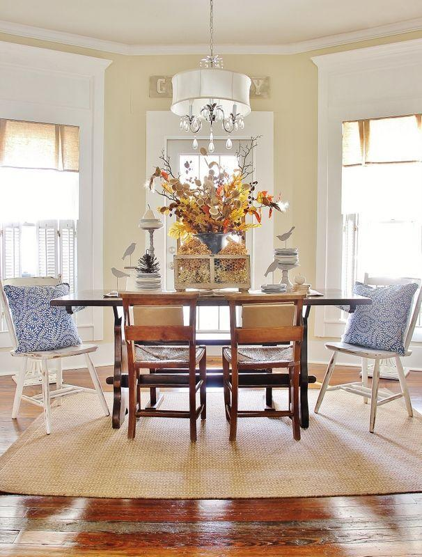 """<p>Bookmarked by stacks of dishes, a wire centerpiece filled with leaves and hydrangeas adds a festive touch in blogger KariAnne Wood's dining room. </p><p><strong>Get the tutorial at <a href=""""http://www.thistlewoodfarms.com/thanksgiving-table-ideas"""" rel=""""nofollow noopener"""" target=""""_blank"""" data-ylk=""""slk:Thistlewood Farms"""" class=""""link rapid-noclick-resp"""">Thistlewood Farms</a>.</strong></p><p><strong><a class=""""link rapid-noclick-resp"""" href=""""https://www.amazon.com/slp/gourd-decorations/5ct8qwd5uto49bg?tag=syn-yahoo-20&ascsubtag=%5Bartid%7C10050.g.2130%5Bsrc%7Cyahoo-us"""" rel=""""nofollow noopener"""" target=""""_blank"""" data-ylk=""""slk:SHOP DECORATIVE GOURDS"""">SHOP DECORATIVE GOURDS</a></strong> </p>"""