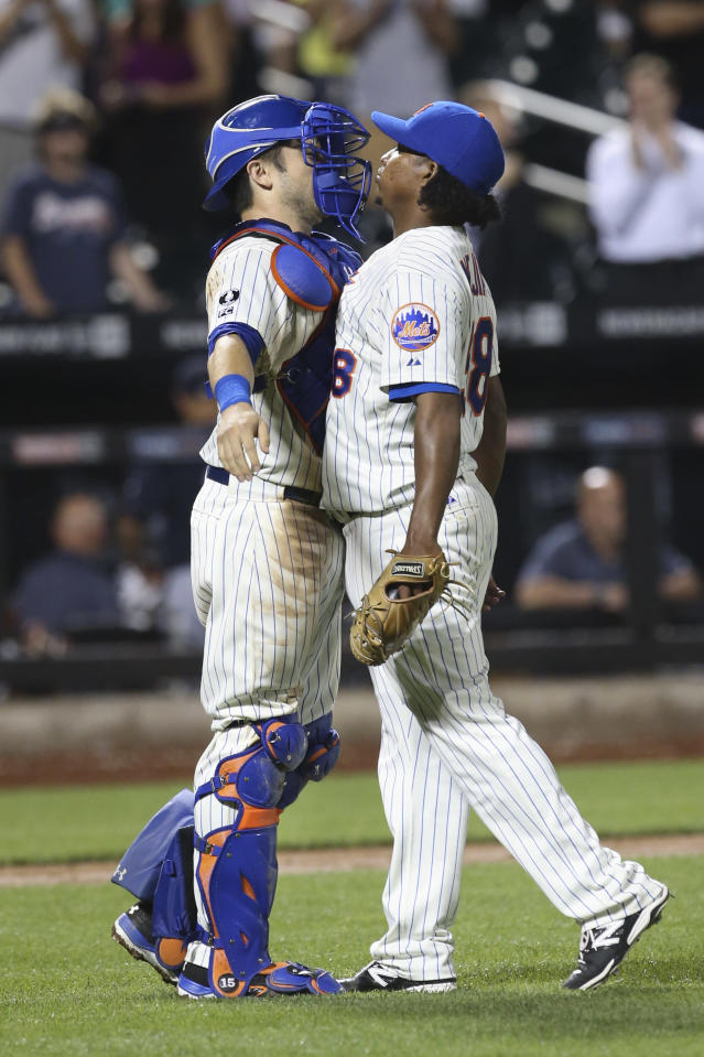 New York Mets relief pitcher Jenrry Mejia, right, and catcher Travis d'Arnaud celebrate after a baseball game against the Atlanta Braves, Tuesday, Aug. 26, 2014, in New York. The Mets won 3-2. (AP Photo/John Minchillo)