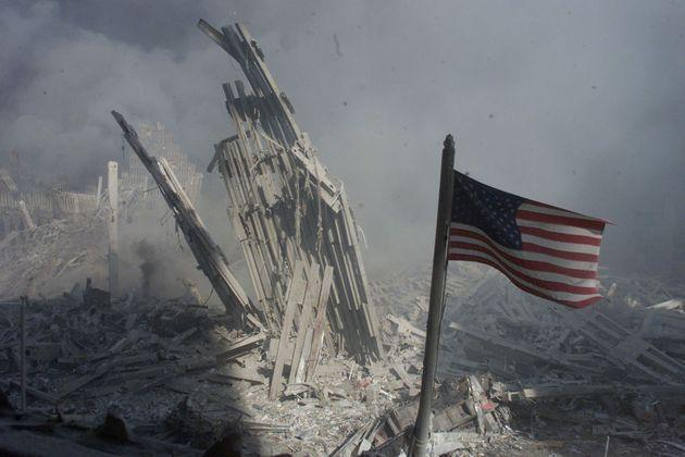 An American flag flies near the base of the destroyed World Trade Center in New York, in this file photo from September 11, 2001, taken after the collapse of the towers. This year's anniversary of the September 11 attacks in New York and Washington will echo the first one, with silence for the moments the planes struck and when the buildings fell, and the reading of 2,792 victims' names. REUTERS/Peter Morgan-Files  HB (Photo: Peter Morgan via REUTERS)