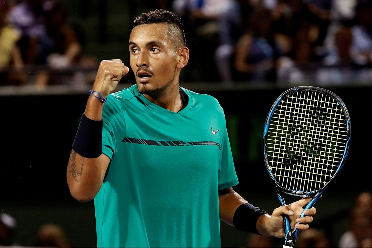 FILE PHOTO: Mar 31, 2017; Miami, FL, USA; Nick Kyrgios of Australia gestures after winning a point against Roger Federer of Switzerland (not pictured) during a men's singles semi-final in the 2017 Miami Open at Brandon Park Tennis Center. Federer won 7-6(9), 6-7(9), 7-6(5). Mandatory Credit: Geoff Burke-USA TODAY Sports/File Photo