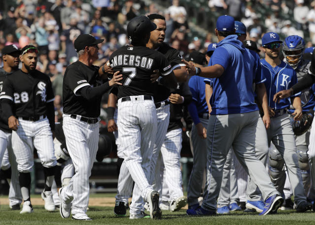 Chicago White Sox's Tim Anderson (7) is restrained by Jose Abreu after he was hit by a pitch from the Kansas City Royals, as benches cleared during the sixth inning of a baseball game in Chicago, Wednesday, April 17, 2019. The Royals won 4-3 in 10 innings. (AP Photo/Nam Y. Huh)
