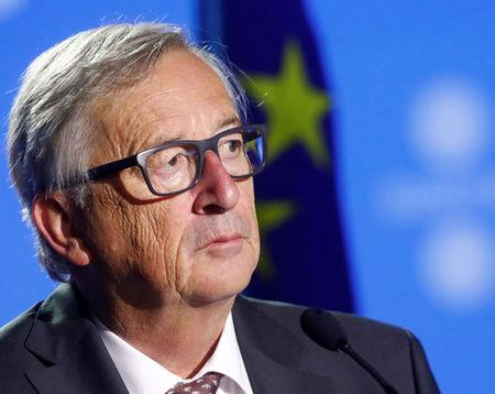 President of the European Commission Juncker listens at a news conference during the European Union Tallinn Digital Summit in Tallinn