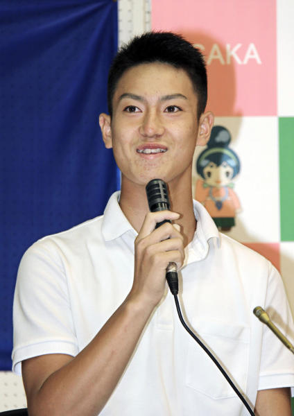 In this July 8, 2018, photo, Kaito Yuki speaks at a press conference in Osaka, western Japan. Yuki is headed to the Kansas City Royals organization instead of attending high school in Japan. The team signed Yuki, a 16-year-old pitcher, out of junior high to a standard seven-year minor league contract Sunday. He is thought to be the first Japanese junior high school player to sign with a major league club. (Kyodo News via AP)