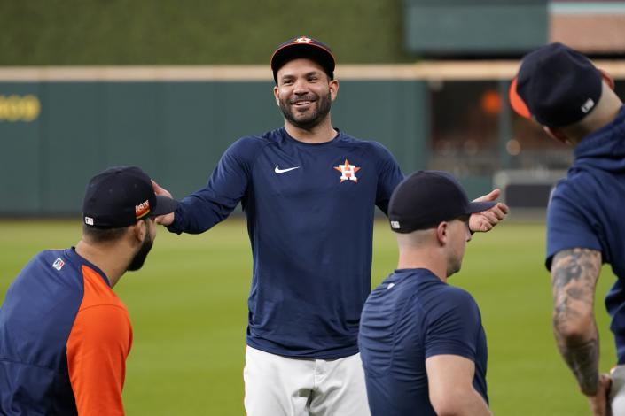 Houston Astros' Jose Altuve smiles as he talks with teammate as the start of a baseball practice in Houston, Thursday, Oct. 14, 2021. The Astros host the Boston Red Sox in Game 1 of the American League Championship Series on Friday. (AP Photo/Tony Gutierrez)