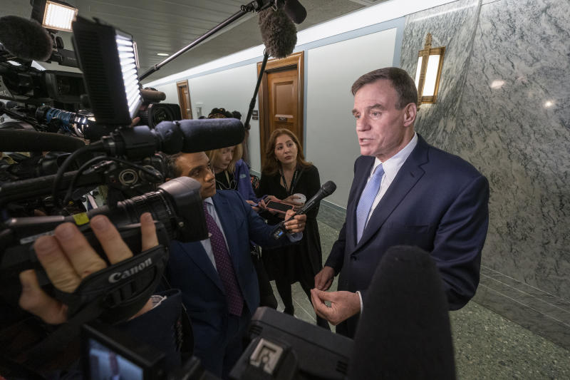 Sen. Mark Warner, D-Va., vice-chair of the Senate Intelligence Committee, responds to reporters about Donald Trump Jr. being subpoened by his panel after he backed out of two scheduled interviews as part of the panel's Russia investigation, on Capitol Hill in Washington, Tuesday, May 14, 2019. (AP Photo/J. Scott Applewhite)
