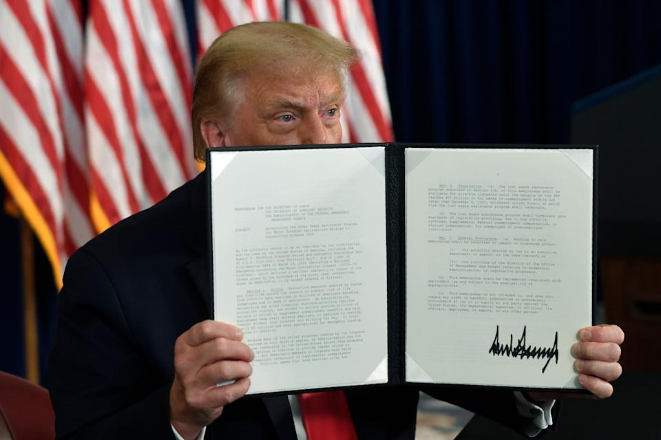 President Donald Trump signs an executive order during a news conference at the Trump National Golf Club in Bedminster, New Jersey, on Aug. 8, 2020. (Photo: AP Photo/Susan Walsh)