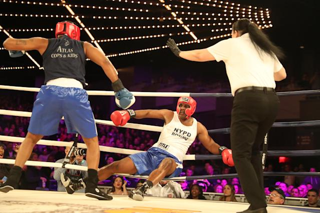 <p>Larry Carson (red) lands on the ropes after being hit by Kevon Sample (blue) in the LT Rumble Match at the NYPD Boxing Championships at the Hulu Theater at Madison Square Garden on March 15, 2018. (Gordon Donovan/Yahoo News) </p>