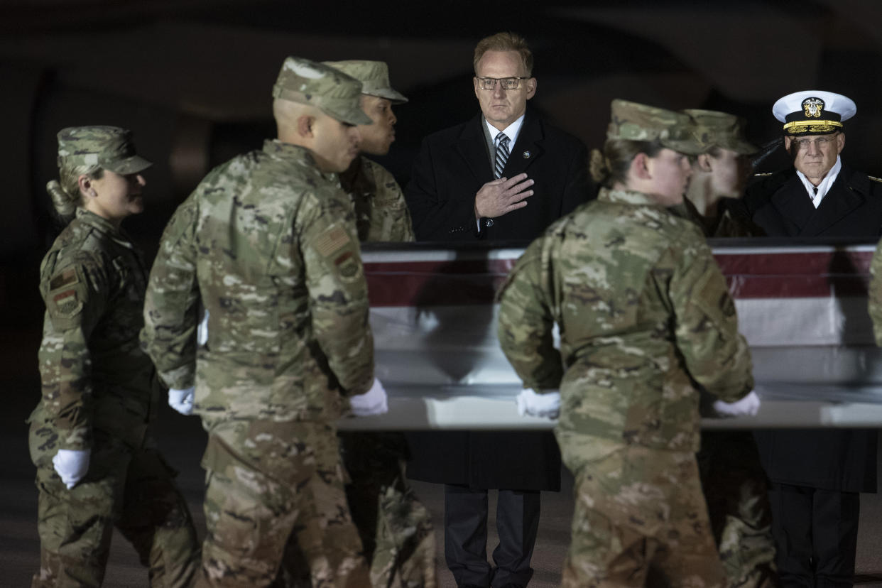 Acting Navy Secretary Thomas Modly, center, and Navy Adm. Michael Gilday, Chief of Naval Operations, look on as an Air Force carry team moves a transfer case containing the remains of Navy Ensign Joshua Kaleb Watson, Sunday, Dec. 8, 2019, at Dover Air Force Base, Del.. According to the Department of Defense, Watson was killed at the Naval Air Station mass shooting, Dec. 6, in Pensacola. (Photo: Cliff Owen/AP)