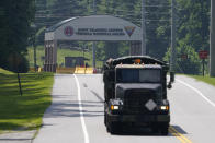 A military truck exits the main gate to Fort Pickett Wednesday, Aug. 25, 2021, in Blackstone, Va. Afghan refugees who have been prescreened by the U.S. Department of Homeland Security have been taken to Fort Lee as well as Fort Pickett according to Virginia Gov. Ralph Northam. (AP Photo/Steve Helber)
