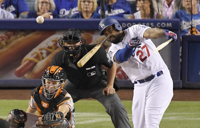 Los Angeles Dodgers' Matt Kemp, right, breaks his bat as he hits a single while San Francisco Giants catcher Buster Posey and home plate umpire Stu Scheurwater watch during the fifth inning of a baseball game Wednesday, Aug. 15, 2018, in Los Angeles. (AP Photo/Mark J. Terrill)