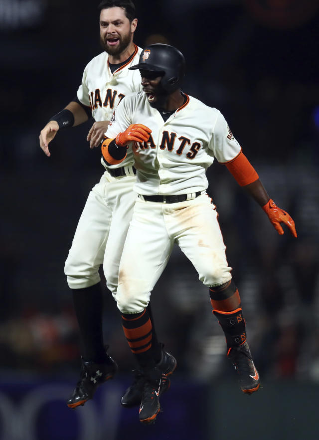 San Francisco Giants' Andrew McCutchen, right, celebrates with Brandon Belt after making the game-winning hit in the ninth inning of a baseball game against the Arizona Diamondbacks, Tuesday, April 10, 2018, in San Francisco. The Giants won 5-4. (AP Photo/Ben Margot)