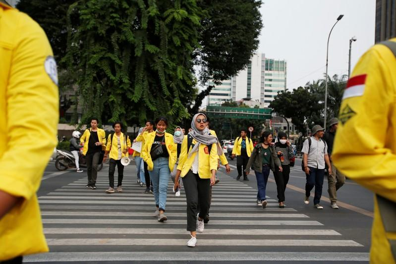 University students take part in a protest over human rights, corruption and social and environmental issues in Jakarta, Indonesia