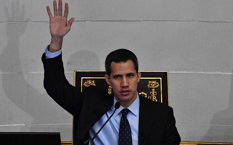 Venezuela's National Assembly head and self-proclaimed 'acting president' Juan Guaido said he believes the military is fed up of the regime - AFP
