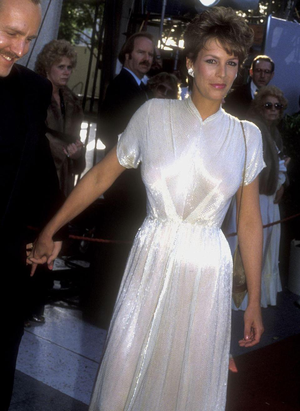 <p>The actress was a vision in this elegant dress and classic '80s hairstyle. The earrings added an extra shine that really completed the ensemble. Less is more, folks! </p>