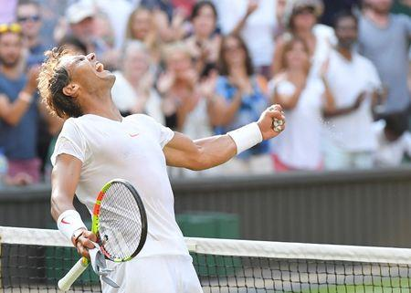 Federer shocked at Wimbledon as Nadal and Djokovic set-up semi-final date