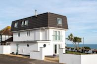 """<p>This large, open-plan beach house rental is a wonderful alternative to checking into a hotel. It sits just two miles from Boscombe Beach and offers glorious sea views and a garden to relax as you soak up the sun and sea air. The luxurious and modern home has four bedrooms and plenty of spaces for you to take in the views from inside.</p><p><strong>Sleeps:</strong> 11 (10 adults + 1 child maximum)</p><p><a class=""""link rapid-noclick-resp"""" href=""""https://go.redirectingat.com?id=127X1599956&url=https%3A%2F%2Fwww.booking.com%2Fhotel%2Fgb%2Fluxurious-modern-home-with-beach-amp-sea-views.en-gb.html%3Faid%3D2070929%26label%3Dbeach-house-rentals&sref=https%3A%2F%2Fwww.redonline.co.uk%2Ftravel%2Finspiration%2Fg36164603%2Fbeach-house-rentals%2F"""" rel=""""nofollow noopener"""" target=""""_blank"""" data-ylk=""""slk:CHECK AVAILABILITY"""">CHECK AVAILABILITY</a></p>"""